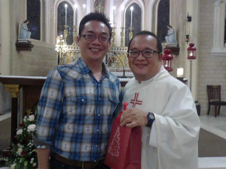 St Peter's choir chairman Dominic Chong presenting gift to Fr Tan