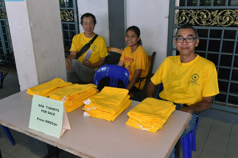 SOA members selling T-shirts for fundraising