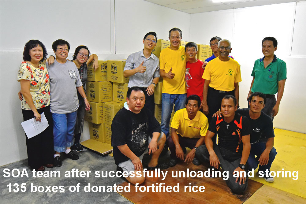 SOA team after hard work of unloading and storing the fortified rice