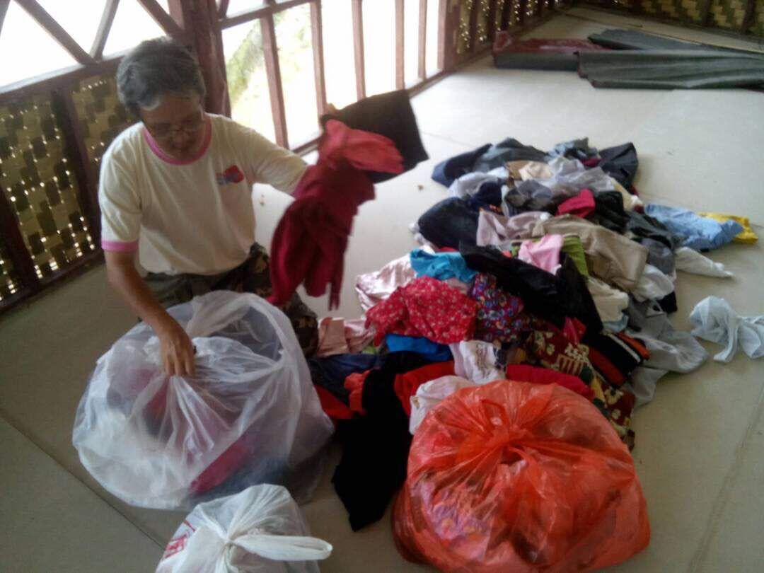 Sorting donated clothes for OA village
