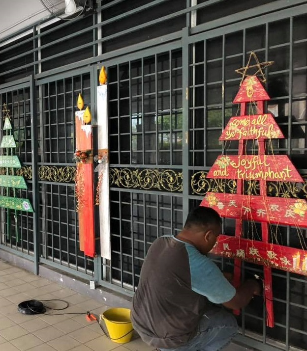 Volunteers decorating the church for Christmas